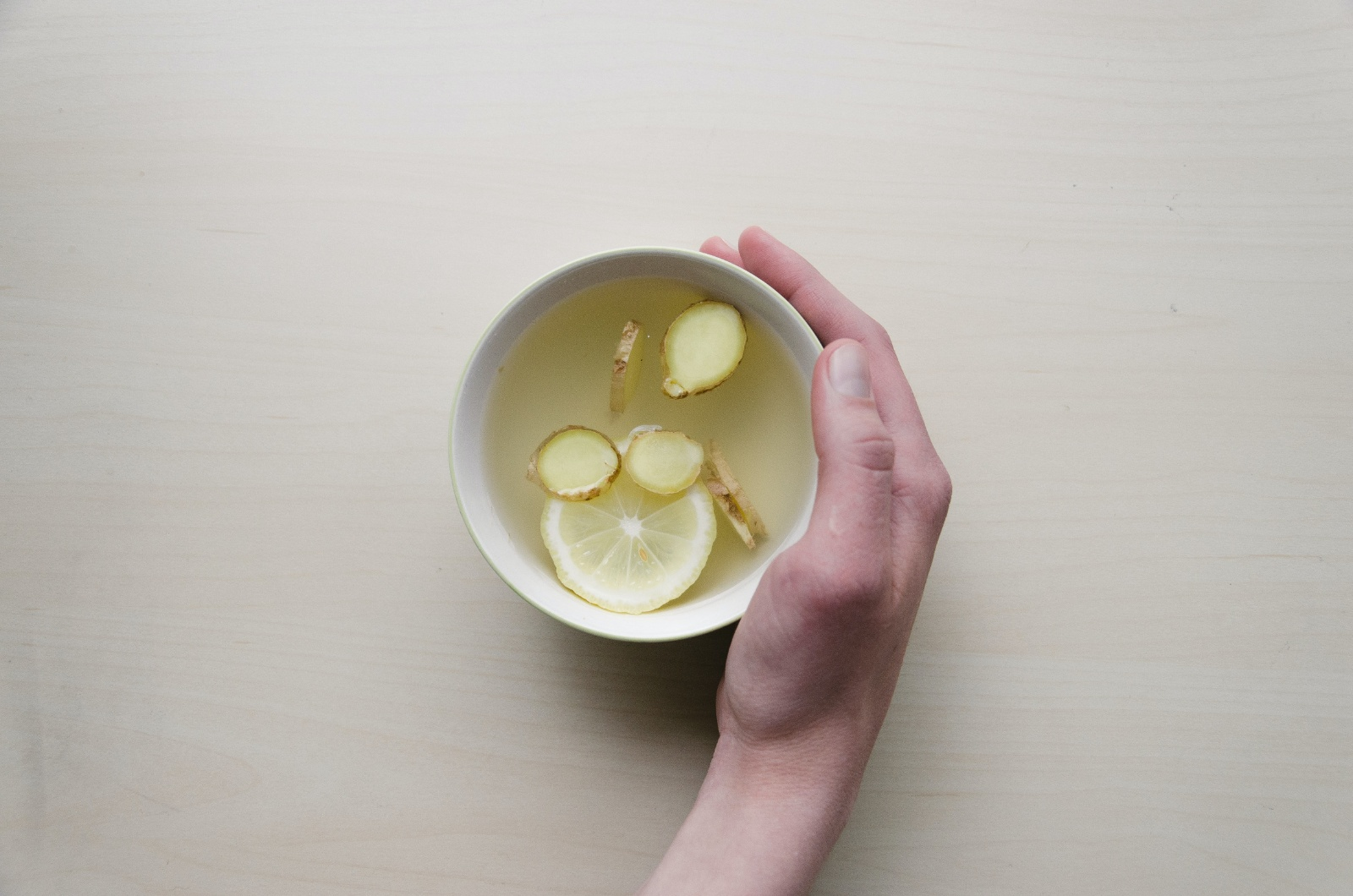 remedies for bloating ginger tea in a white mug