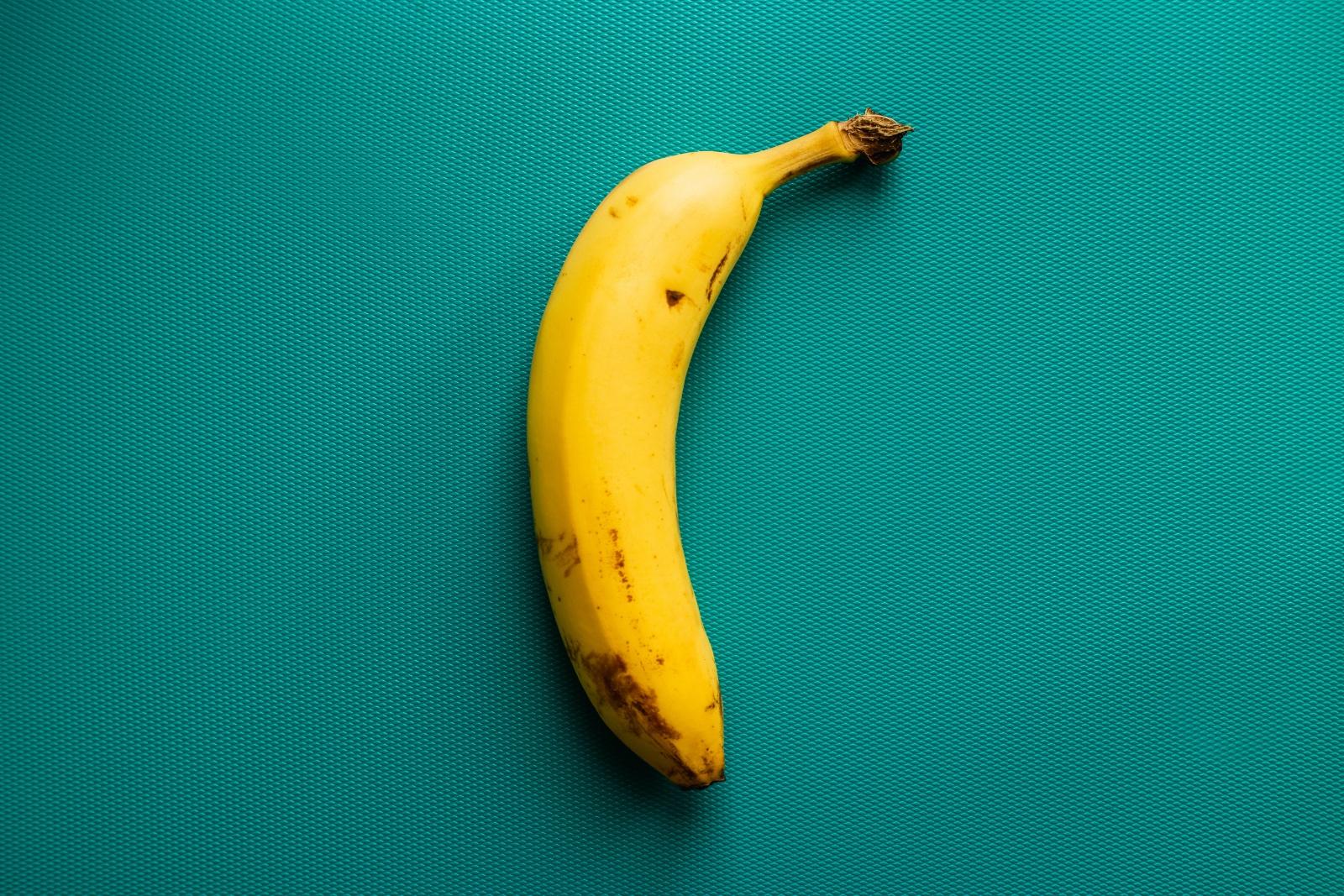 ripe banana on tea background