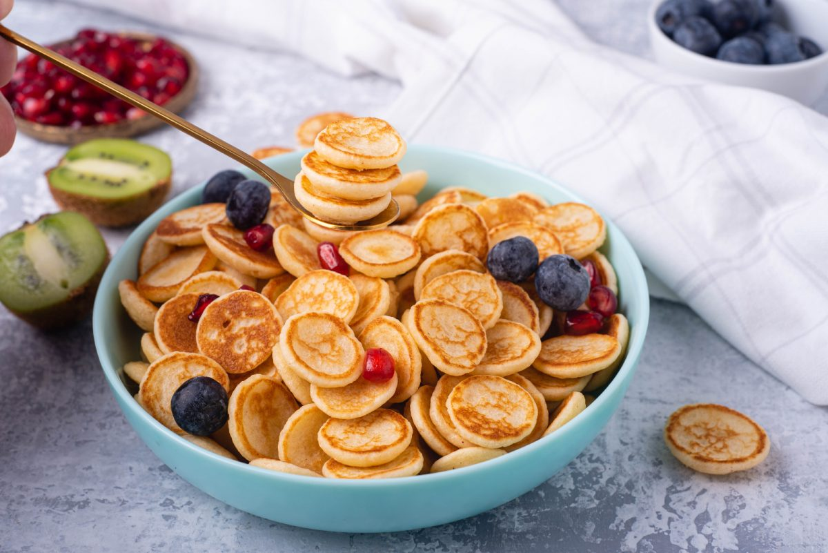 blogilates cassey ho mini cereal pancakes in a bowl with fresh fruit